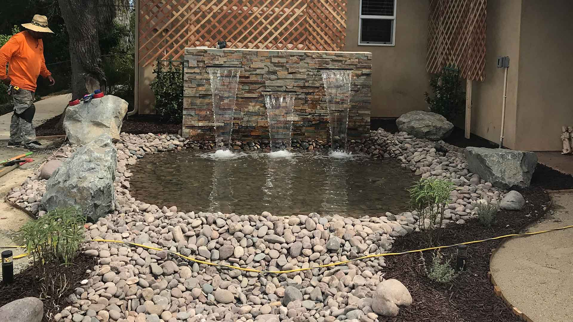 Custom water feature in a residential yard in Poway, CA.