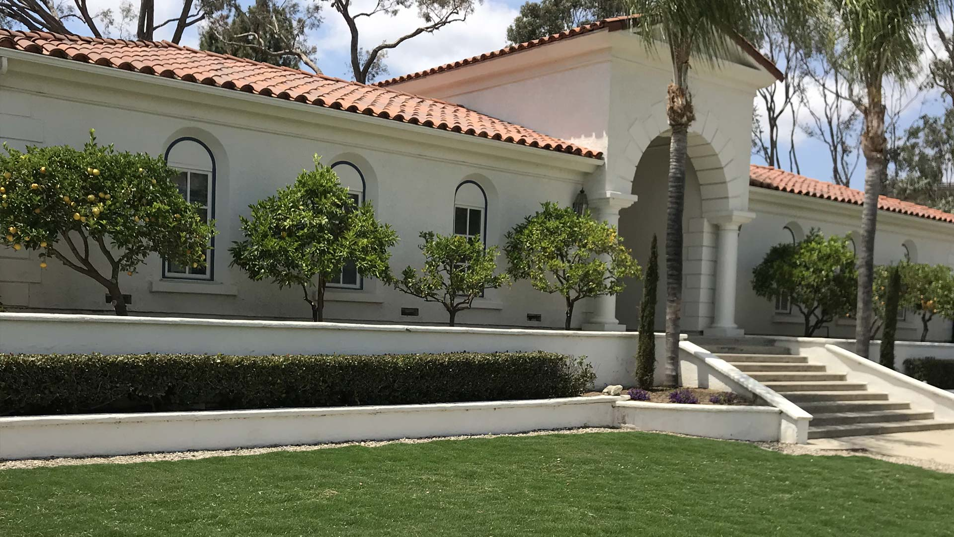 Tree care and landscaping services for a home in Carlsbad, CA.