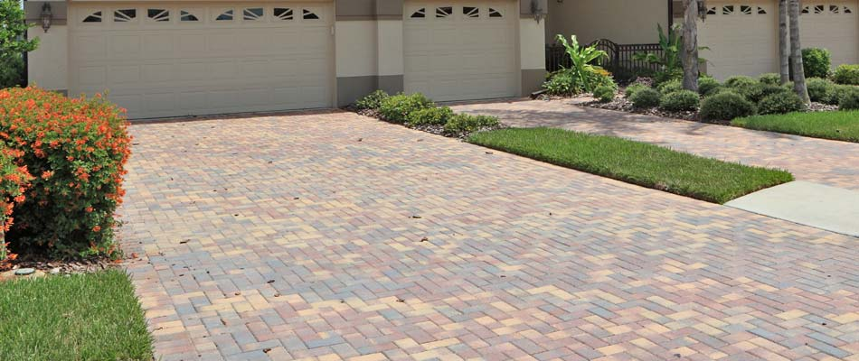 Decorative driveway with multi color pavers at a home in Carlsbad, CA.