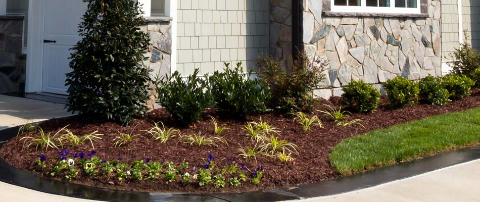 New mulch installed in front of a residential property that's included in our full maintenance package in Carlsbad.