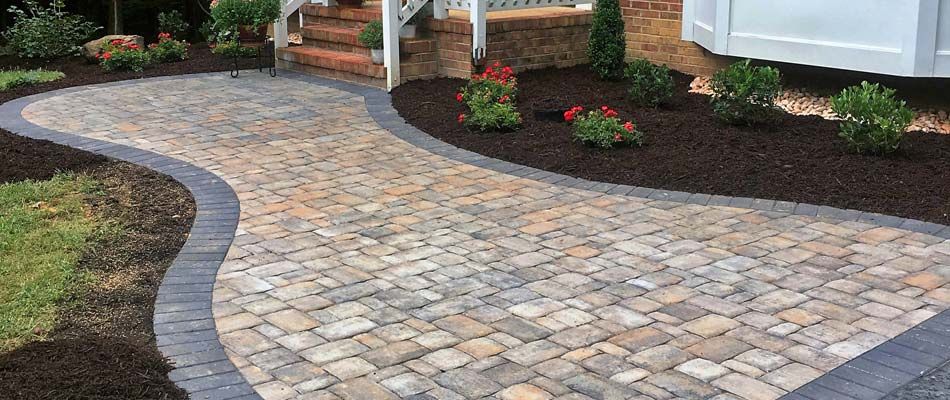 Brick paver walkway installed in front of a home in Carlsbad, CA.