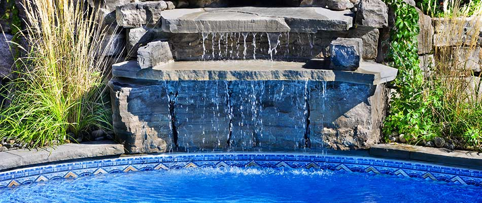 Pool with a waterfall and custom landscaping in La Jolla, CA.