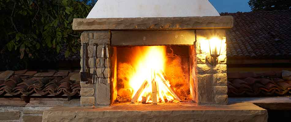 Wood-burning fireplace at a property in Carlsbad, CA.