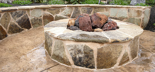 Custom fire pit designed and installed by our team of professionals.