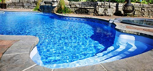 Beautiful blue pool at a Carlsbad, CA home property.